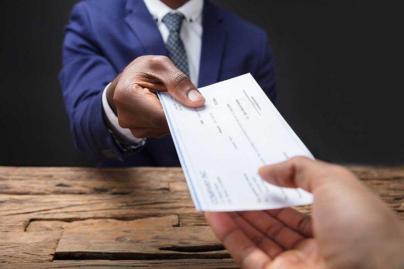 man giving check