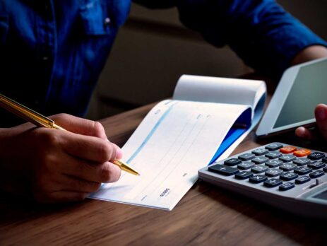 woman writing cheque